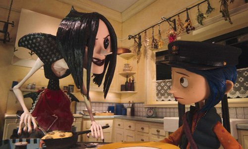 A spidery-looking Other Mother leans over Coraline with a creepy smile.