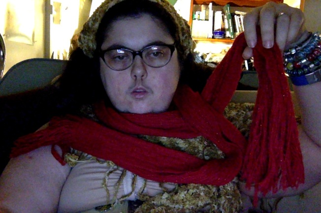 Me with a red scarf around my neck, with fringe on the end