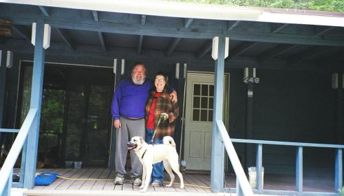 My parents in front of their home in the California Siskiyou mountains, with their dog Daisy.