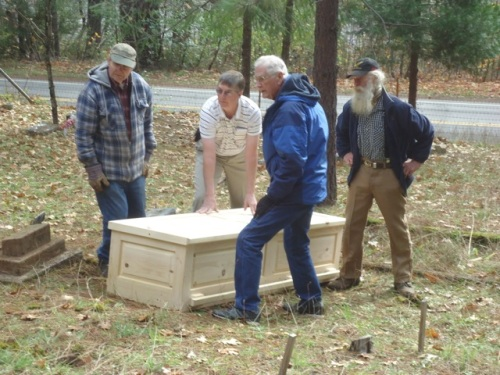 Four old men and my dad's pine box.